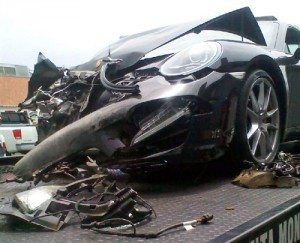 AP - Lohan's totalled Porsche on the tow truck.